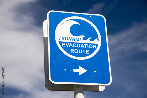 Tsunami flood evacuation route roadside sign