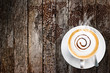 Coffee cup and saucer on old wood background