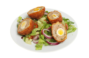Scotch eggs and salad