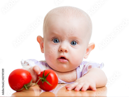 baby girl with tomatoes