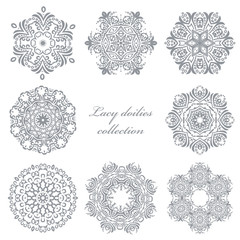 Lacy doilies set isolated on white.