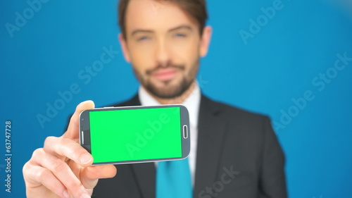 businessman with his smartphone showing the empty screen
