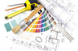 Architect's work tools on blueprints background