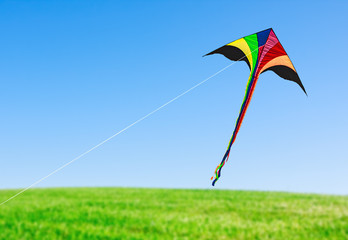 kite with tail in clear blue sky