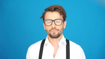 handsome man wearing glasses on blue