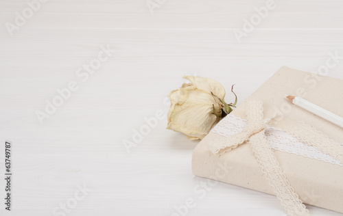 Notebook With Natural Linen Cover. Dried Rose. White Wooden Back