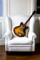 Electric Guitar on an Armchair