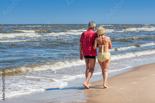 Couple strolling at coastline