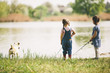 canvas print picture - Two little girls at fishing
