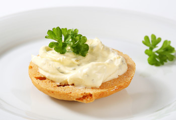 Cracker with cheese spread