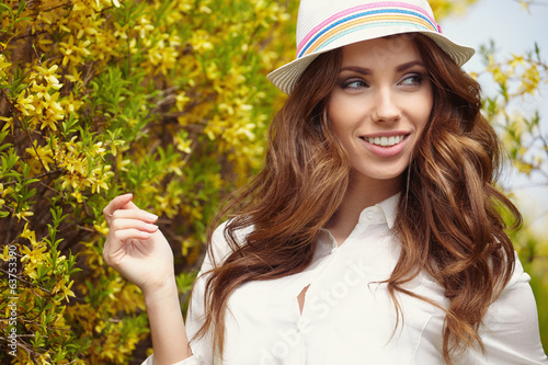 Pretty spring woman in the garden