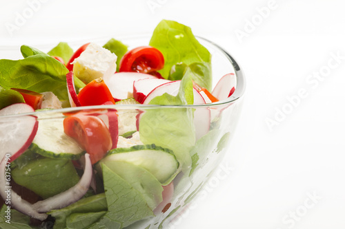 Fresh vegetable salad with cucumber and radish
