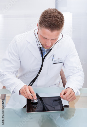 Doctor analyzing the health of tablet computer
