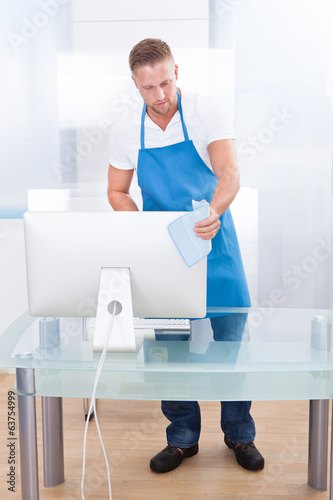 Janitor or cleaner cleaning an office