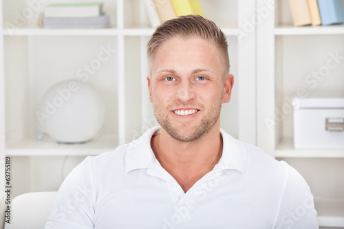 Smiling man at home