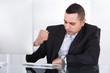 Stressed Businessman At Computer Desk