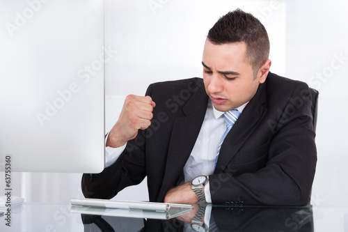 Stressed Businessman At Computer Desk