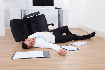 Businessman Fallen From Office Chair