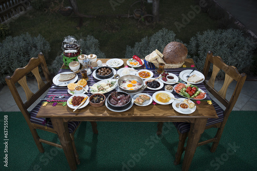 Rich and delicious Turkish breakfast on wooden table
