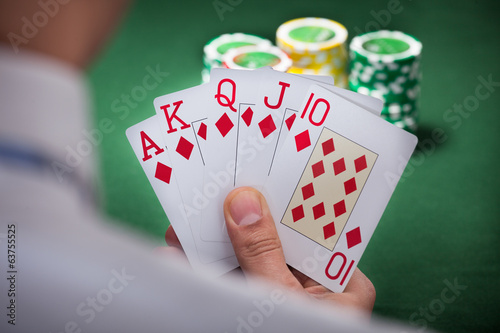 Man Playing Winning Hand Of Poker