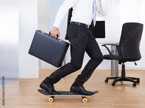 Businessman On Skateboard In Office