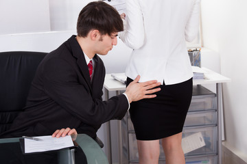 Pervert Businessman Touching Female Colleague's Buttock