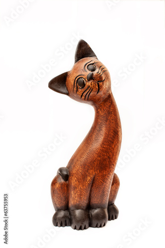 Old ornamental wooden cat isolated