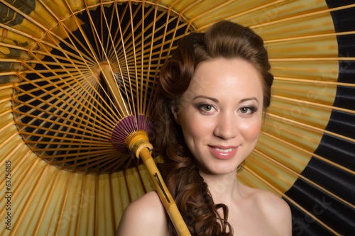 Beautiful woman with traditional Japanese umbrella