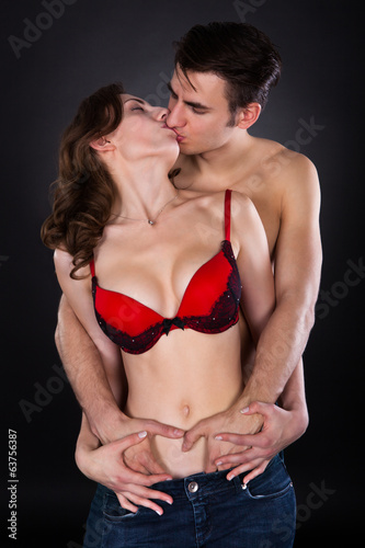 Passionate Couple Over Black Background