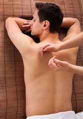 Young Man Receiving Back Massage In Spa © Andrey Popov
