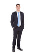 Confident Businessman Standing With Hands In Pockets