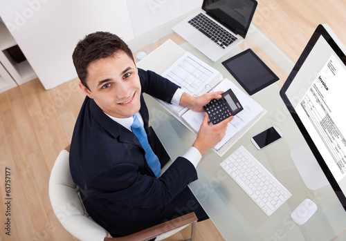 Businessman Calculating Tax
