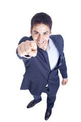 Handsome business man pointing finger at you, isolated on white