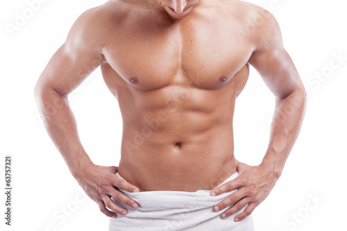 canvas print picture Muscular man in towel, isolated on white