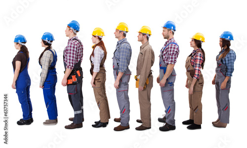 Construction workers standing in queue