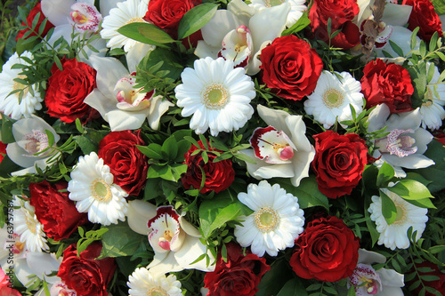Cymbidium orchids, red roses and white gerberas