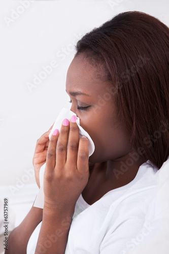 Woman Suffering From Cold At Home
