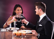 Couple Toasting Wineglasses At Restaurant Table