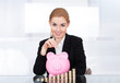 Businesswoman Inserting Coin In Piggybank