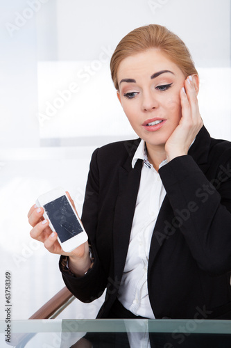 Businesswoman Holding Smartphone With Cracked Screen