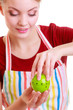 Happy housewife or chef in kitchen apron using apple timer