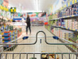 View from shopping cart trolley at supermarket shop. Retail. - 63758590