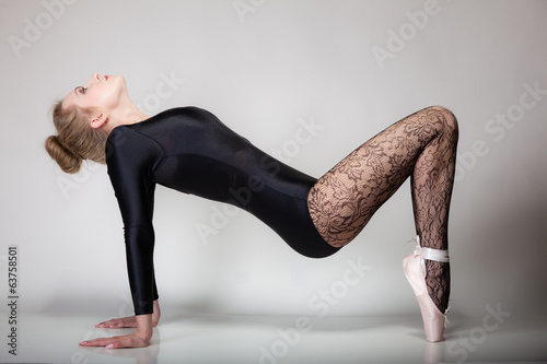 modern style woman ballet dancer full length on gray