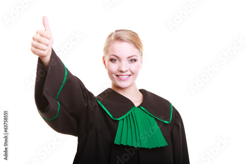 Young female lawyer attorney wearing polish black green gown