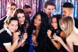 Friends Singing Into Microphones At Karaoke Party