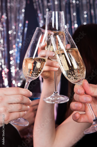Friends Toasting Champagne At Nightclub