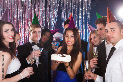 Woman Celebrating Birthday With Friends At Nightclub