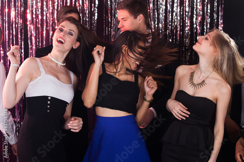 Women Enjoying Party With Friends At Nightclub