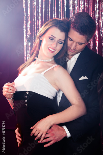 Couple Dancing At Nightclub