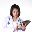 woman doctor looking at a table